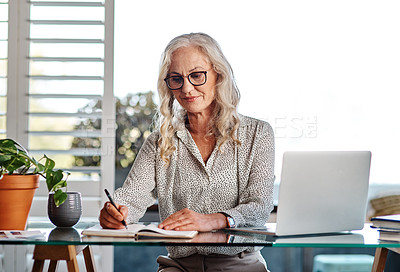 Buy stock photo Cropped shot of an attractive senior businesswoman working from home
