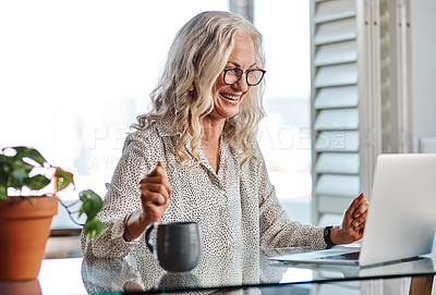 Buy stock photo Cropped shot of an attractive senior businesswoman cheering while working from home