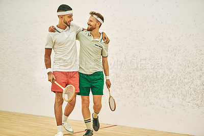 Buy stock photo Shot of two young men embracing at a squash court