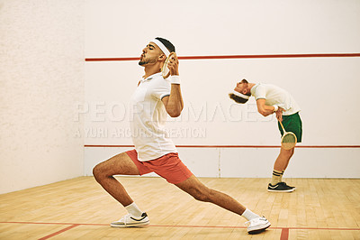 Buy stock photo Shot of two young men stretching before playing a game of squash