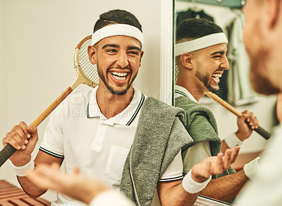 Buy stock photo Shot of two young men chatting in the locker room after a game of squash