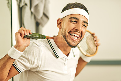 Buy stock photo Portrait of a happy young man holding his squash racket in the locker room