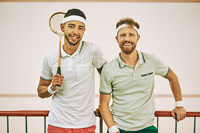 Buy stock photo Shot of two young men on the viewing gallery of a squash court