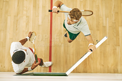 Buy stock photo High angle shot of two young men at a squash court
