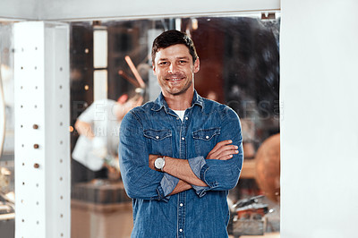 Buy stock photo Portrait of a handsome young businessman posing in an office inside his workshop
