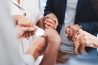 Buy stock photo Closeup shot of a group of unrecognisable businesspeople holding hands together in a huddle