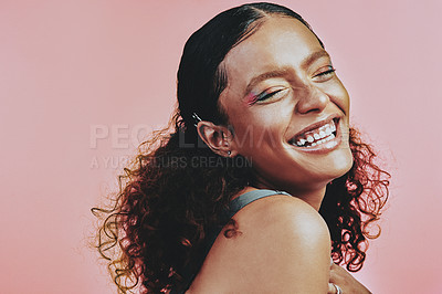 Buy stock photo Shot of a beautiful young woman wearing makeup while posing against a pink background