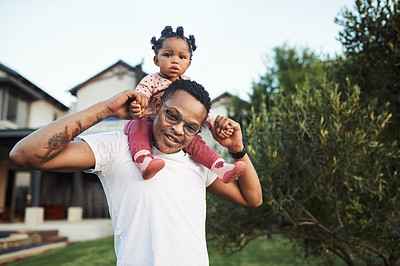 Buy stock photo Shot of an adorable baby girl having fun with her dad in their backyard