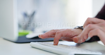 Buy stock photo Closeup shot of an unrecognisable businessman using a computer in an office
