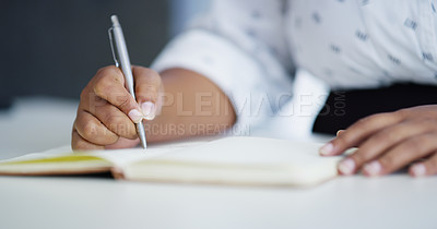 Buy stock photo Closeup shot of an unrecognisable businesswoman writing in a notebook in an office
