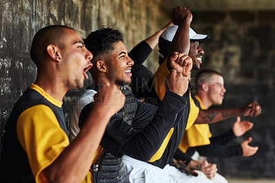 Buy stock photo Cropped shot of a group of young baseball players cheering and supporting their team from the bench during a game