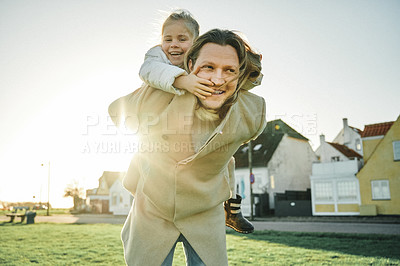 Buy stock photo Portrait of an adorable little girl playing and spending time with her father outdoors at a park