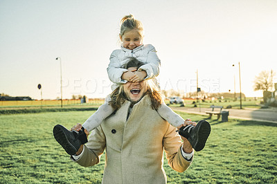 Buy stock photo Cropped shot of an adorable little girl playing and spending time with her father outdoors at a park