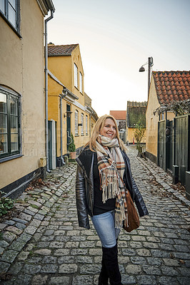 Buy stock photo Cropped shot of an attractive young woman traveling and walking outdoors in a foreign town