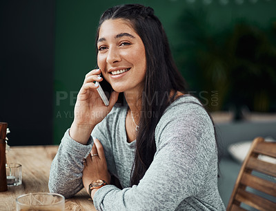 Buy stock photo Shot of a beautiful young woman using a smartphone at a cafe