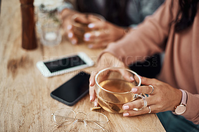 Buy stock photo Cropped shot of a woman having a warm beverage at a cafe
