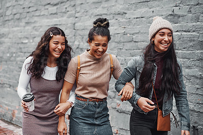 Buy stock photo Cropped shot of an attractive group of sisters bonding during a day out in the city together