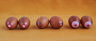 Buy stock photo Studio shot of eggs against a coloured background