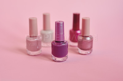 Buy stock photo Still life shot of nail polish bottles against a pink background