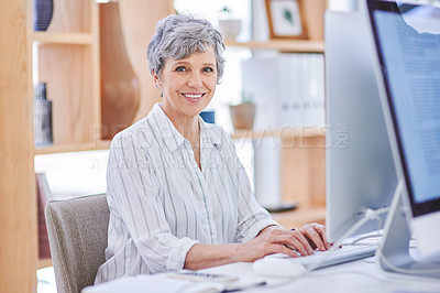 Buy stock photo Portrait of a mature businesswoman working on a computer in an office
