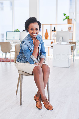 Buy stock photo Portrait of a young businesswoman sitting on a chair in an office