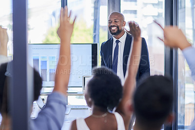 Buy stock photo Shot of a group of businesspeople raising their hands during a seminar