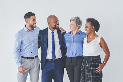 Buy stock photo Cropped shot of a group of businesspeople posing together against a white background