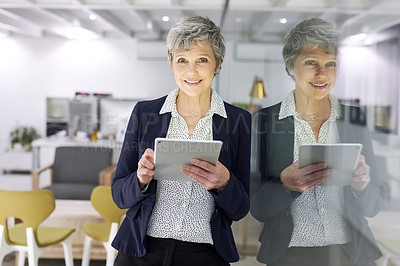 Buy stock photo Portrait of an attractive mature businesswoman using a digital tablet inside her office