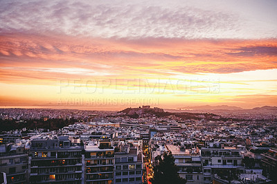 Buy stock photo Cropped shot of a beautiful sky setting over Athens in Greece during the late hours of the evening