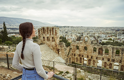 Buy stock photo Cropped shot of an attractive young woman standing alone near the Odeon of Herodes Atticus while sight-seeing in Greece