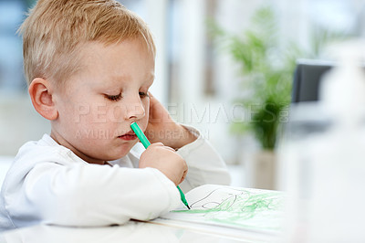 Buy stock photo Cropped shot of an adorable little boy busy drawing at home