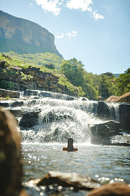 Buy stock photo Cropped shot of an unrecognizable woman swimming in a stream alone during a day outdoors