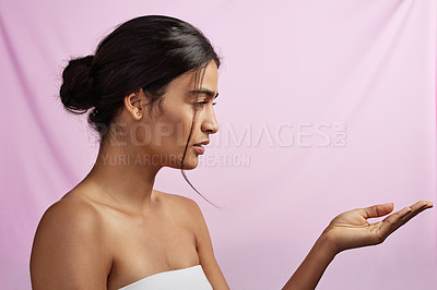 Buy stock photo Studio shot of a beautiful young woman posing against a pink background