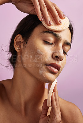 Buy stock photo Studio shot of a beautiful young woman posing with a face mask on her skin