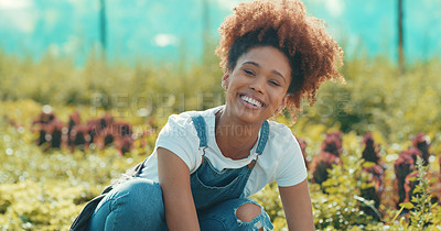 Buy stock photo Cropped portrait of an attractive young female farmer smiling while working in a crop field during  the day