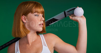 Buy stock photo Cropped shot of an attractive young sportswoman standing and posing with hockey equipment against a green studio background
