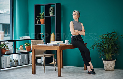 Buy stock photo Shot of a mature businesswoman in a modern office