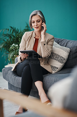 Buy stock photo Cropped shot of an attractive mature businesswoman sitting alone and using technology in her home office