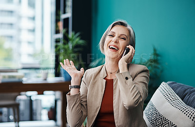 Buy stock photo Cropped portrait of an attractive mature businesswoman sitting alone and talking on her cellphone in her home office