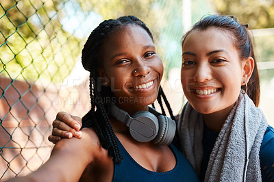 Buy stock photo Portrait of two sporty young women taking selfies together outdoors