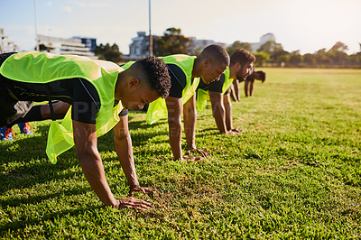 Buy stock photo Cropped shot of a diverse group of sportsmen training during a rugby practice in a sports club