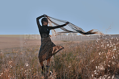 Buy stock photo Full length shot of an attractive young woman standing alone and posing in a meadow during the day