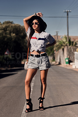 Buy stock photo Shot of a beautiful young woman out and about in the city