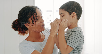 Buy stock photo Cropped shot of a mother helping her adorable young son floss his teeth in their bathroom at home