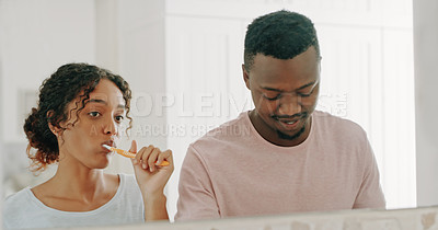 Buy stock photo Cropped shot of a happy young couple brushing their teeth and getting ready together in their bathroom at home