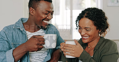 Buy stock photo Cropped shot of a happy young couple drinking coffee and spending time together at home