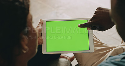 Buy stock photo Cropped shot of an unrecognizable young couple using a digital tablet while relaxing together at home