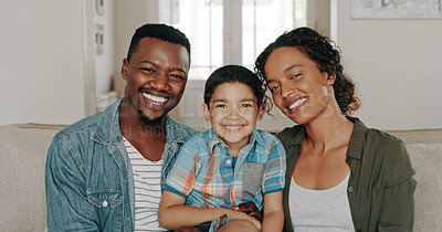 Buy stock photo Portrait of a happy young family of three bonding and spending time together at home