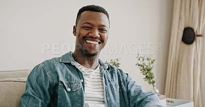 Buy stock photo Portrait of an handsome young man feeling cheerful and confident while spending the day at home