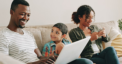 Buy stock photo Cropped shot of a happy young family using their electronic devices while relaxing and spending time together at home